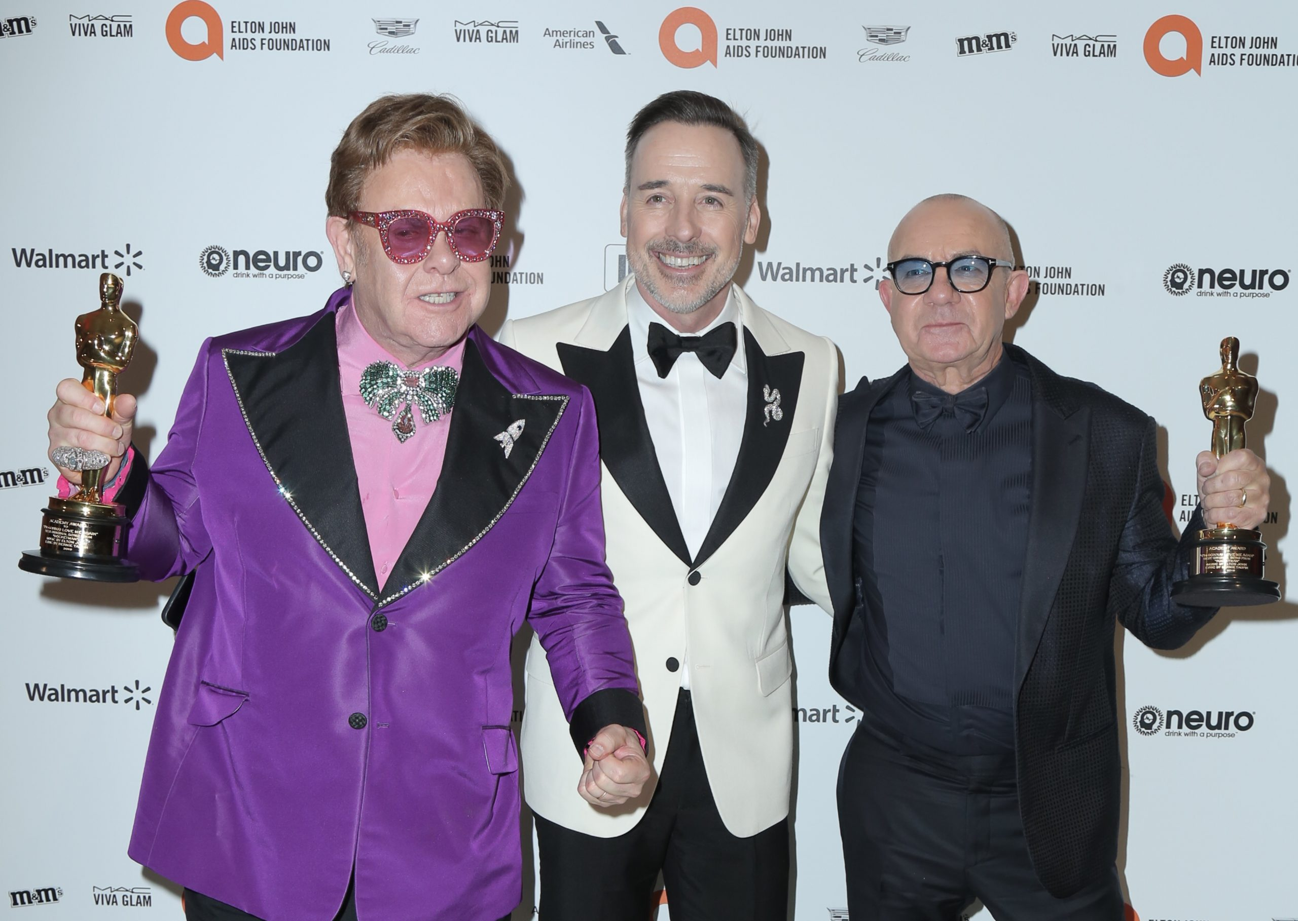 28th Annual Elton John Academy Awards Viewing Party held at West Hollywood Park. Photo Credit: PMA/AdMedia Pictured: Elton John,David Furnish,Bernie Taupin Ref: SPL5147565 090220 NON-EXCLUSIVE Picture by: PMA/AdMedia / SplashNews.com Splash News and Pictures Los Angeles: 310-821-2666 New York: 212-619-2666 London: +44 (0)20 7644 7656 Berlin: +49 175 3764 166 photodesk@splashnews.com World Rights