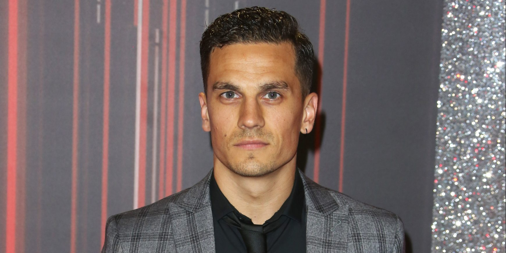 Former EastEnders star Aaron Sidwell warns fans after having a knife pulled on him