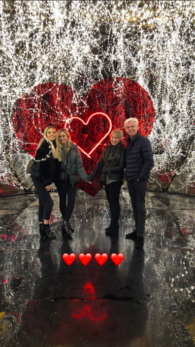 Phillip Schofield and family in front of heart in Paris
