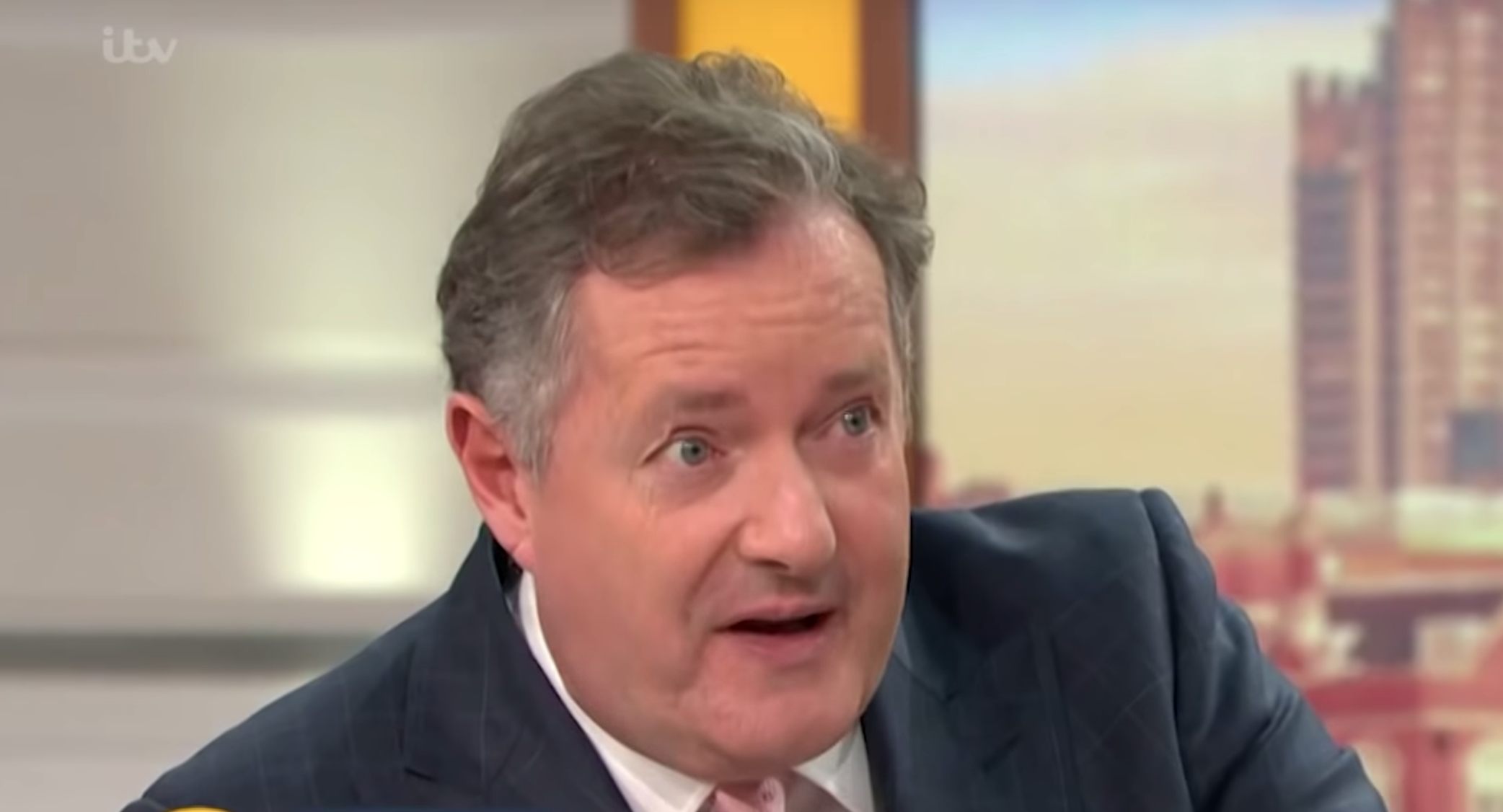 Piers Morgan jokes he's considering self-isolation over coronavirus fears after kissing Peter Andre