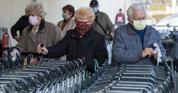 Elderly people wearing masks in the outbreak, as people ask when coronavirus will end