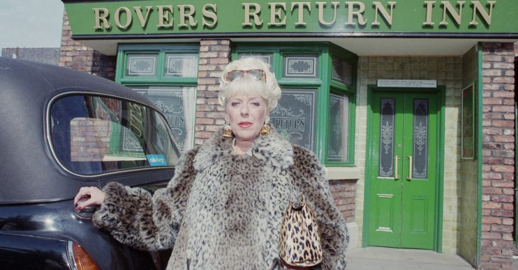 Editorial use only Mandatory Credit: Photo by Shutterstock (6374758l) Publicity shots of Julie Goodyear (as Bet Gilroy) (Episode 3922, 16th October 1995), as she leaves the Rover Return pub, in a taxi, in her iconic leopard-skin outfit. 'Coronation Street' TV Series - Oct 1995