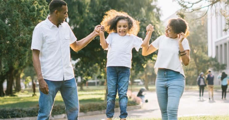 Mother, father and daughter playing. Households all over UK to get council tax holiday as authorities roll out coronavirus support measures