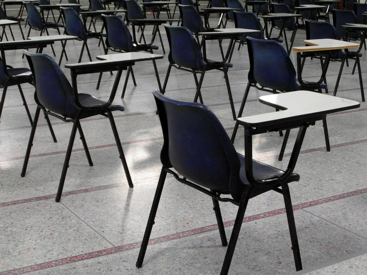 Empty school chairs. Schools to re-open after Easter if UK coronavirus lockdown continues to work, say ministers