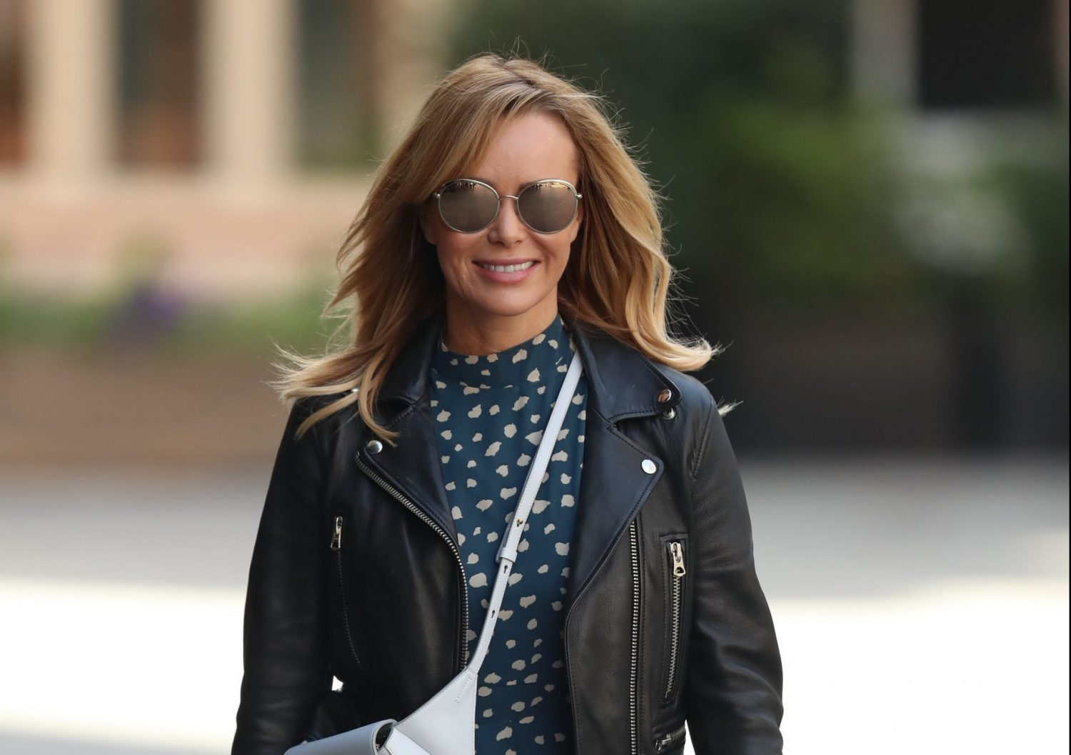 Amanda Holden shows off her incredible figure in cartwheel competition with daughter Hollie