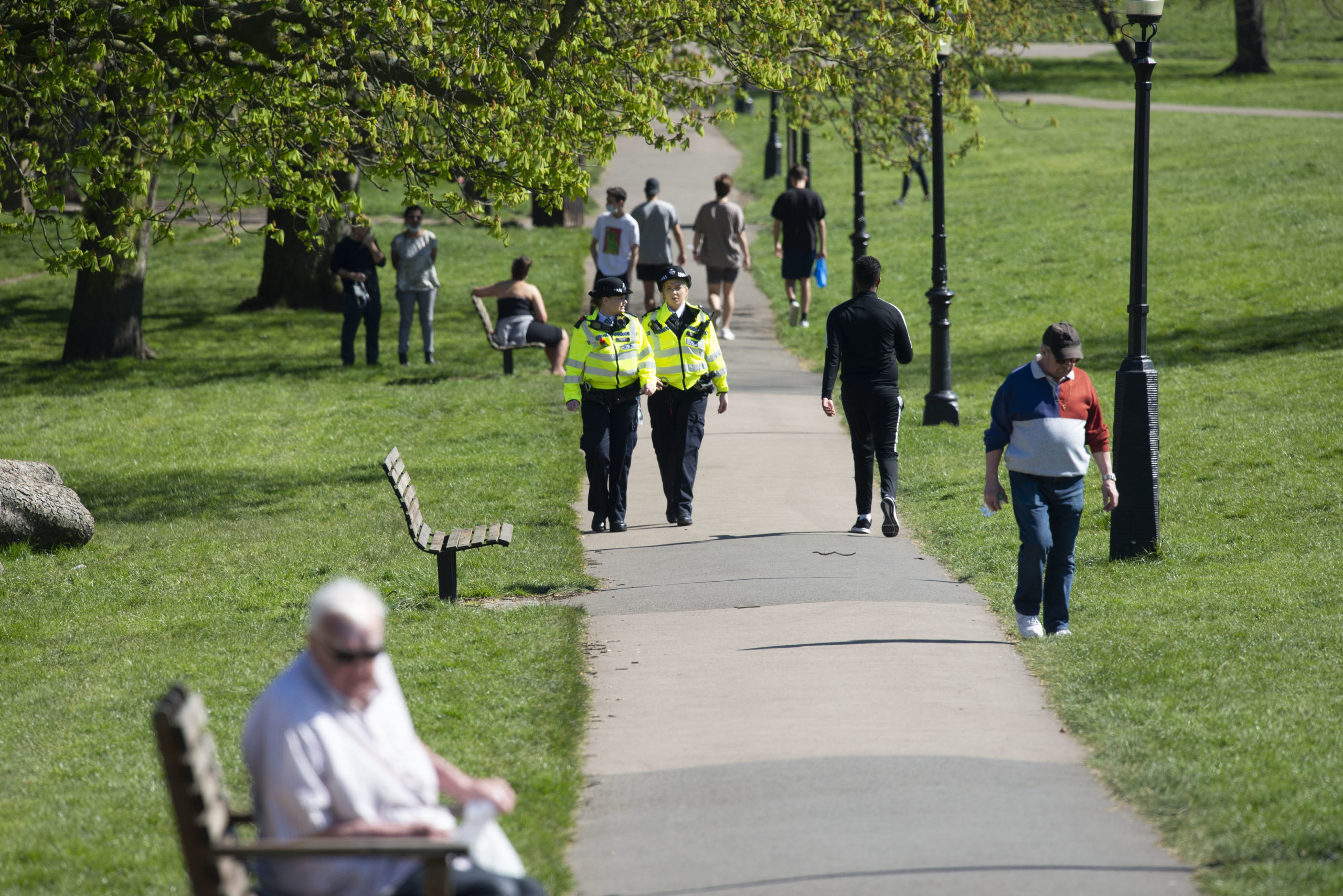 UK police in a park. Dominic Raab has set out the government's five key targets before lifting lockdown