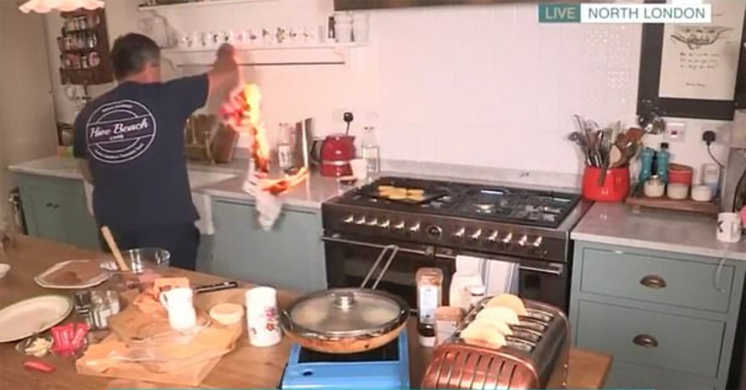 Phillip Schofield and Holly Willoughby horrified as John Torode almost catches kitchen on fire on This Morning