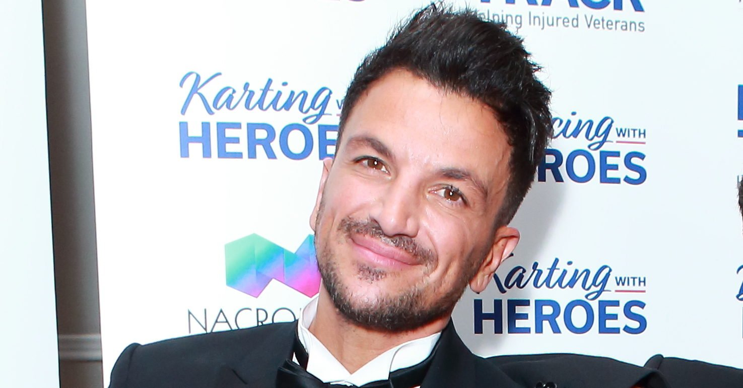 Peter Andre admits he's 'in the dog house' with wife Emily after showing son Theo's face on live TV