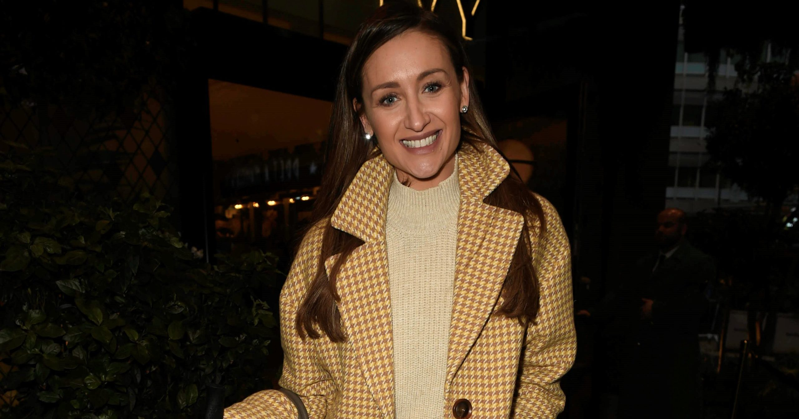 Pained Catherine Tyldesley playfully slaps her husband as he tries to remove splinter