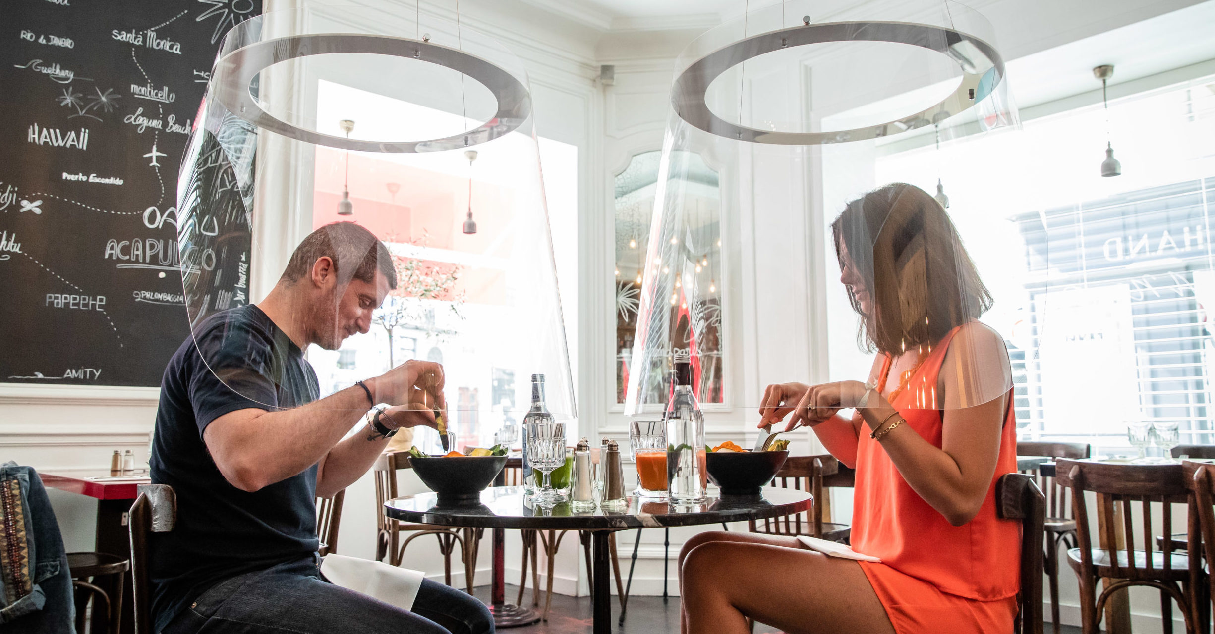 Restaurants could reopen next month with diners eating under lampshade-like plexiglass bubbles