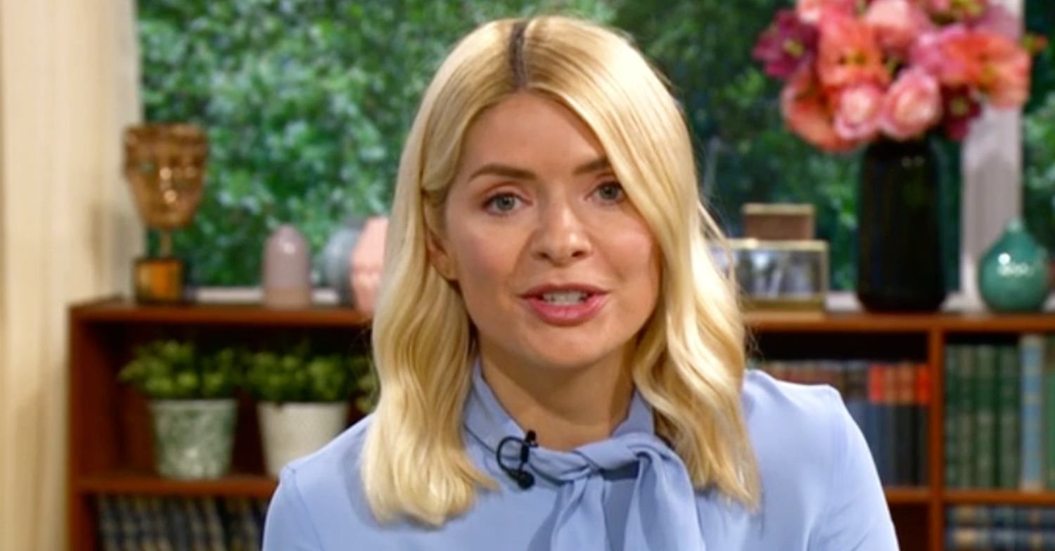 Holly Willoughby looks far from blue as she hosts This Morning in 'gorgeous' blouse