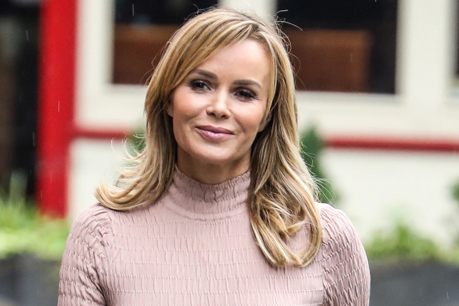 Amanda Holden leaves little to the imagination in fitted dress