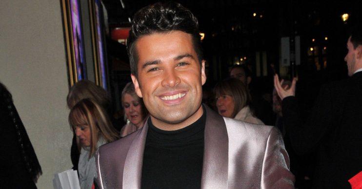 Joe McElderry smiles in red carpet photo