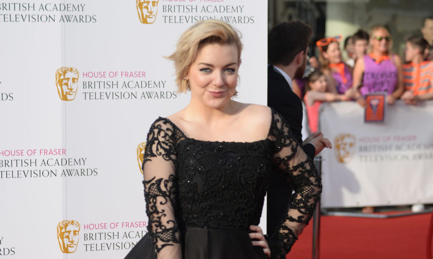 Sheridan Smith beams with pride as she poses with newborn son for rare pic