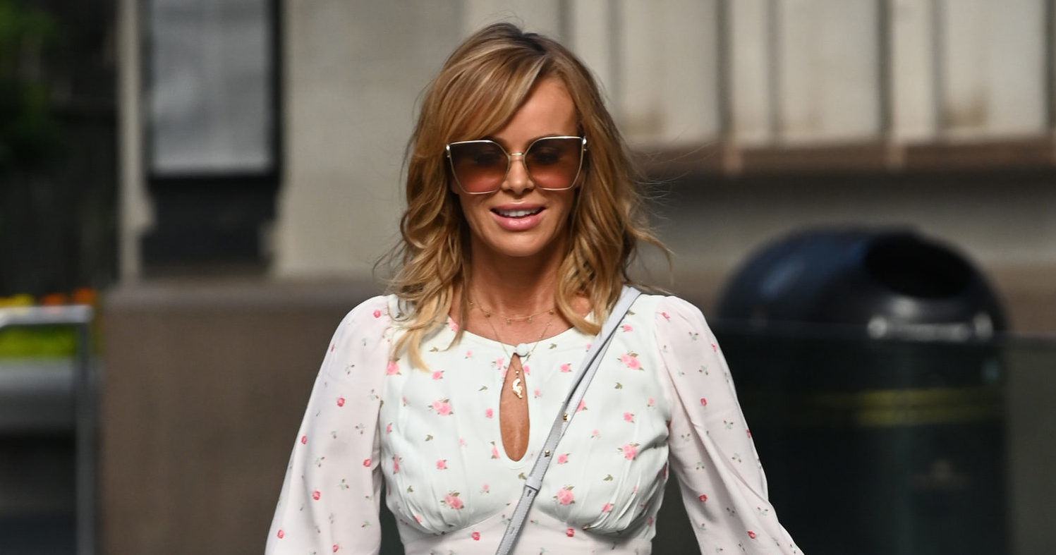 Amanda Holden stuns in blue bikini as she enjoys a mystery seaside holiday