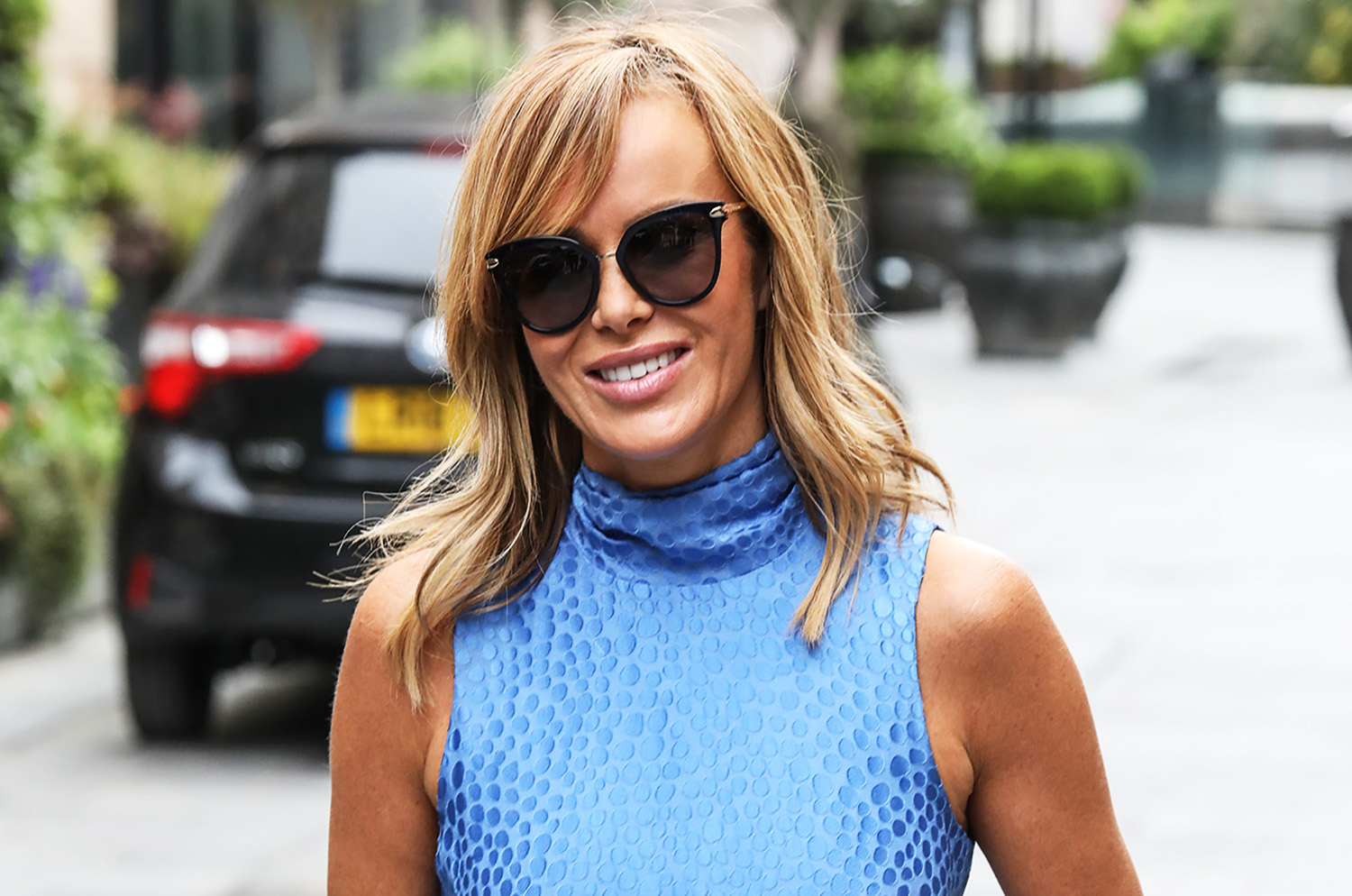 Amanda Holden showcases toned figure in skimpy red bikini