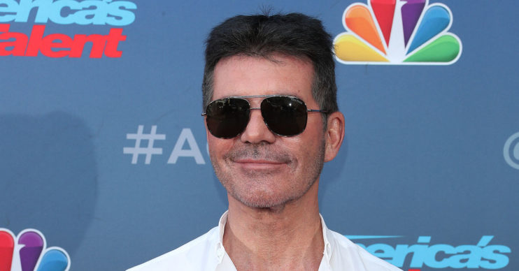 simon cowell back broken
