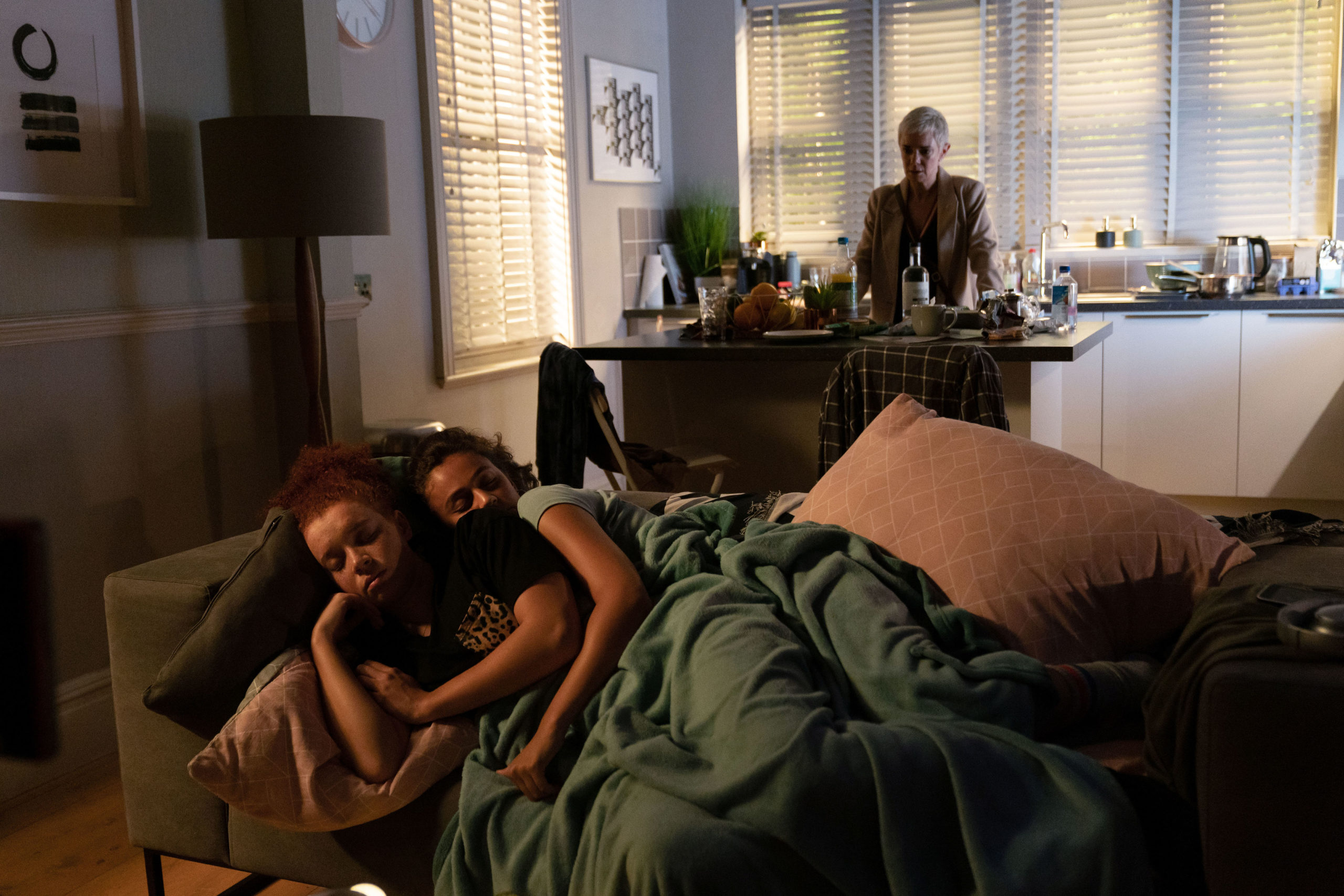 Maya and her girlfriend sleeping in Belle's flat