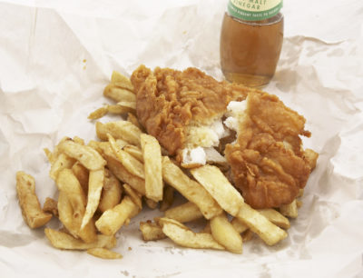 traditional fish and chips in paper from a chip shop
