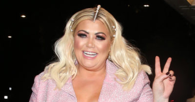 gemma collins giving the peace sign