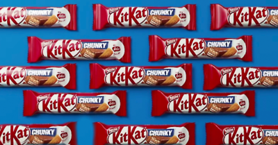 montage of KitKat chunky biscoff bars on blue background