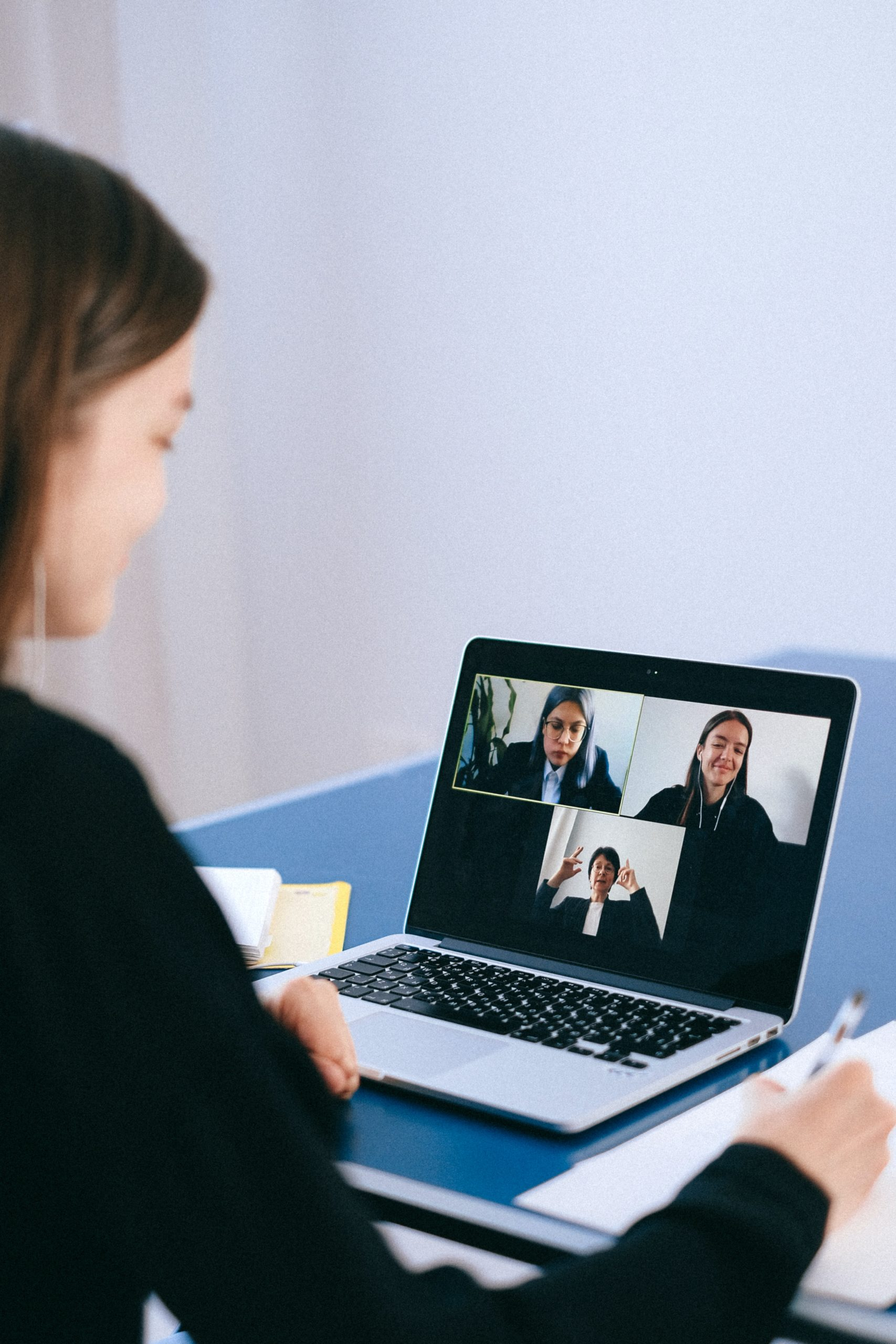 woman sitting on laptop on a Zoom video call