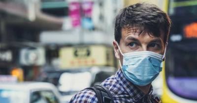 man wearing a face mask in the city