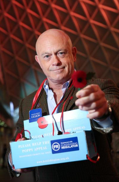 Ross Kemp holding a poppy for Poppy Appeal day