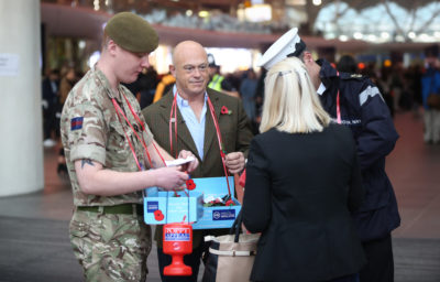 Ross Kemp giving out poppies with soldiers