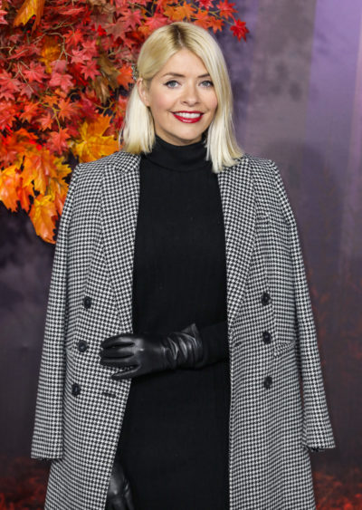 holly Willoughby posing in a coat