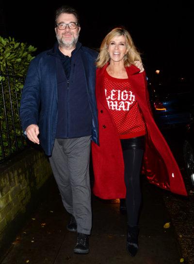 Derek Draper walking along with Kate Garraway