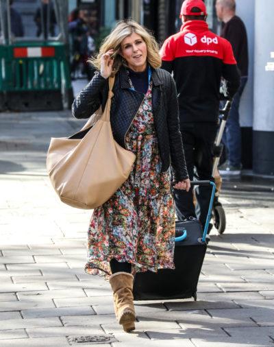 Kate Garraway wearing a coat walking along the street