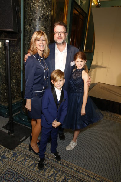 Kate Garraway and her family at a party posing