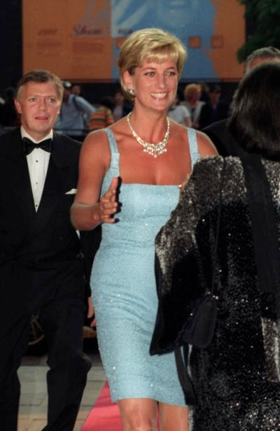 Princess Diana in a blue dress at a party