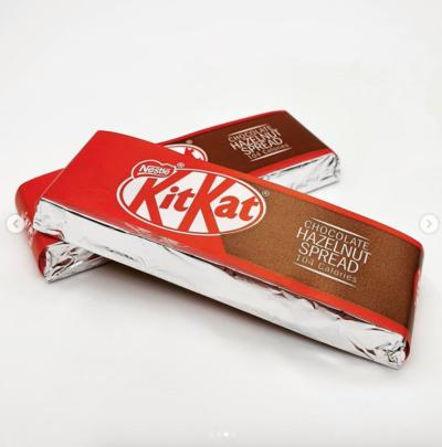 Two bars of wrapped KitKat Hazelnut Spread