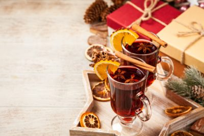 two glasses of mulled wine next to Christmas presents