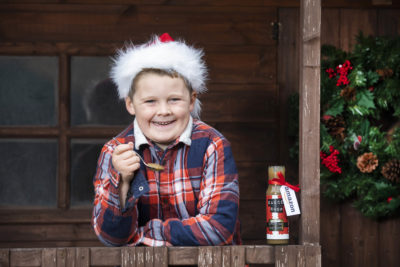 Little boy who created stuffing ketchup posing with his invention