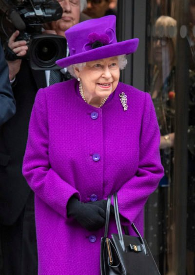 The Queen in purple at a royal engagement