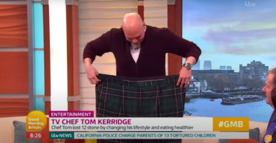 Tom Kerridge shows off weight loss by holding up trousers