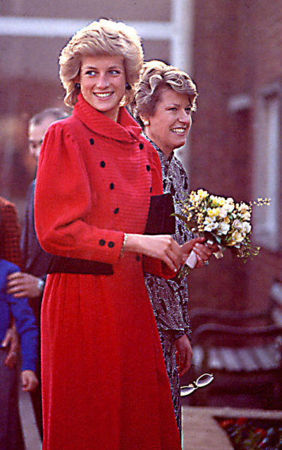 Princess Diana wearing a red coat