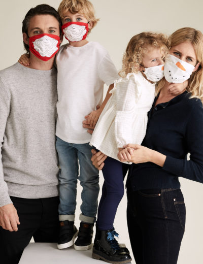 family wearing christmas face mask