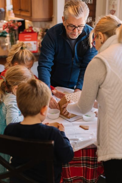 family making a gingerbread house