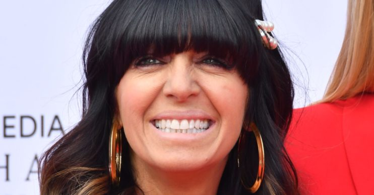 Claudia Winkleman smiles on red carpet