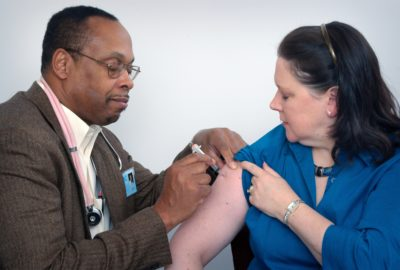 doctor giving someone a vaccinationn