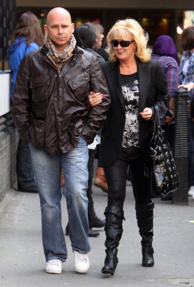 Beverley Callard walks arm in arm with husband Jon