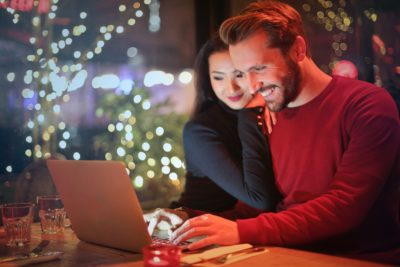 couple doing their Christmas shopping online