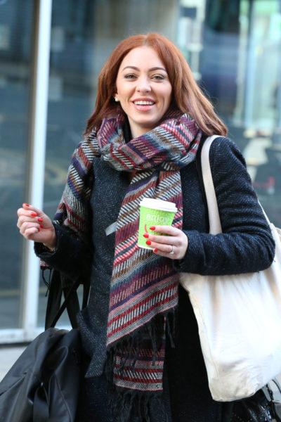 Natasha Hamilton wearing a coat and carrying coffee