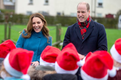 William and Kate out and about with children in Santa hats