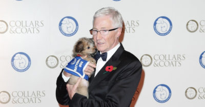 paul o'grady with a puppy at battersea event
