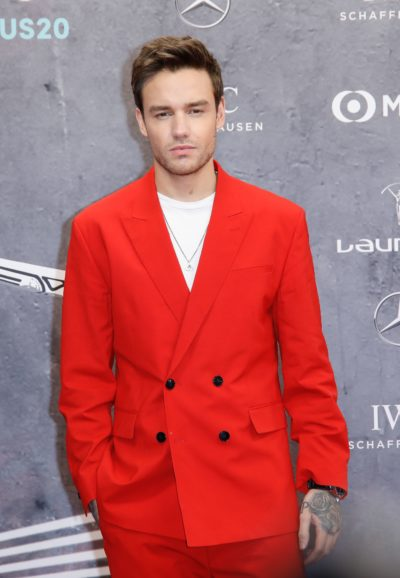 Liam payne in a red jacket